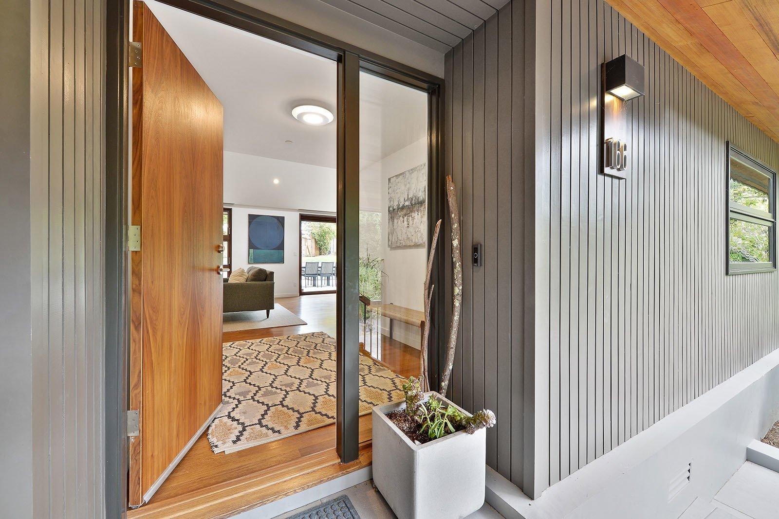 Outdoor, Front Yard, Pavers Patio, Porch, Deck, Small Patio, Porch, Deck, and Tile Patio, Porch, Deck Front door  Portola Valley by patrick perez/designpad architecture