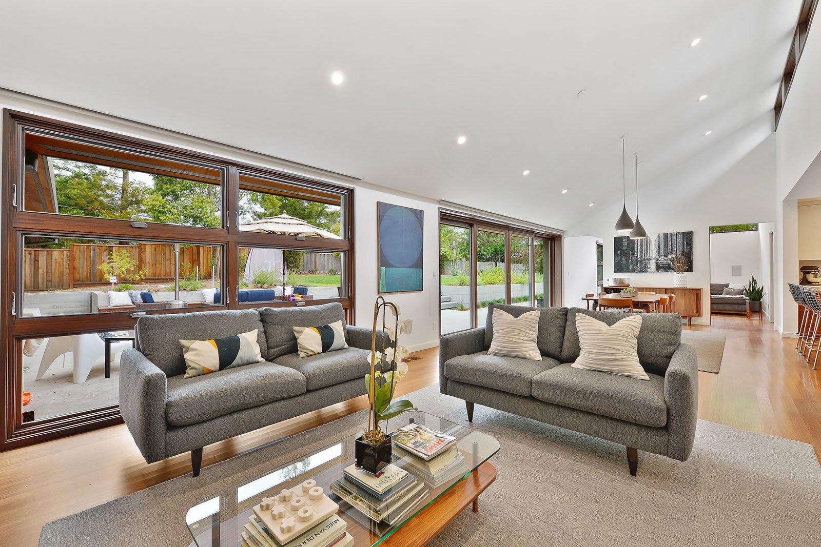 Living Room, Coffee Tables, Pendant Lighting, Sofa, Ceiling Lighting, and Medium Hardwood Floor Living room  Portola Valley by patrick perez/designpad architecture