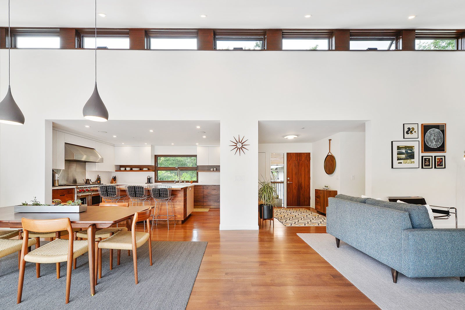 Dining Room, Chair, Stools, Table, Lamps, Ceiling Lighting, Pendant Lighting, and Medium Hardwood Floor Living room  Portola Valley by patrick perez/designpad architecture