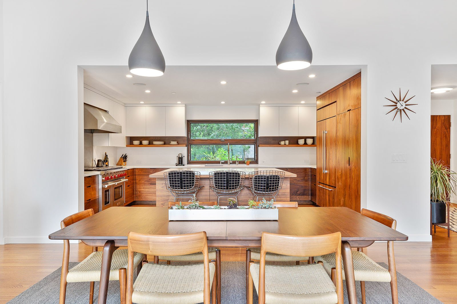 Dining Room, Table, Lamps, Chair, Pendant Lighting, Medium Hardwood Floor, and Ceiling Lighting Dining room  Portola Valley by patrick perez/designpad architecture