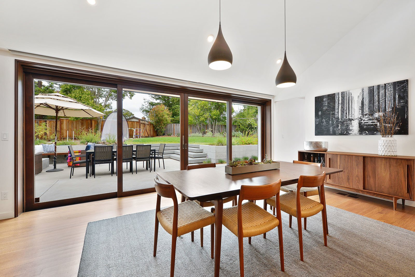 Dining Room, Table, Ceiling Lighting, Chair, Medium Hardwood Floor, and Pendant Lighting Dining room  Portola Valley by patrick perez/designpad architecture