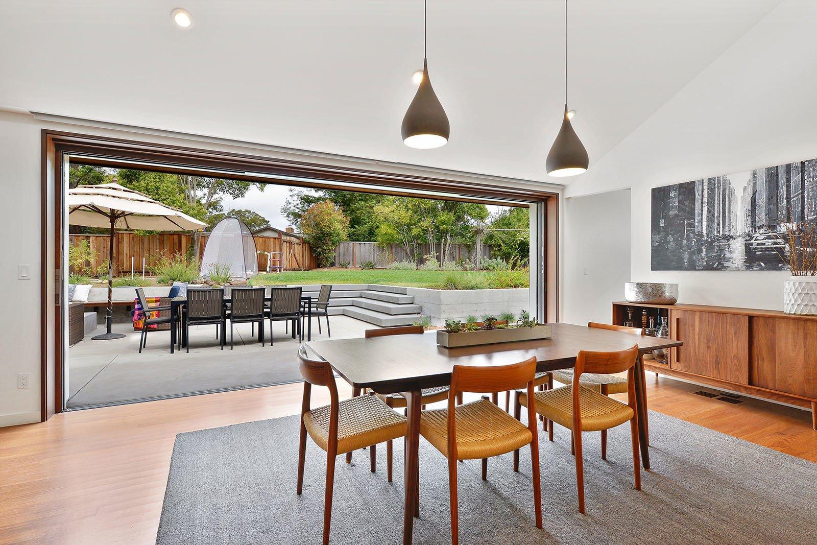 Dining Room, Chair, Pendant Lighting, Table, and Medium Hardwood Floor Dining room  Portola Valley by patrick perez/designpad architecture
