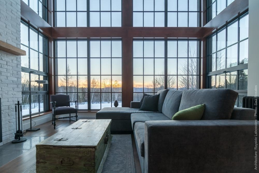 The living room was designed to face West in order to catch the sunset.  La Maison Hatley