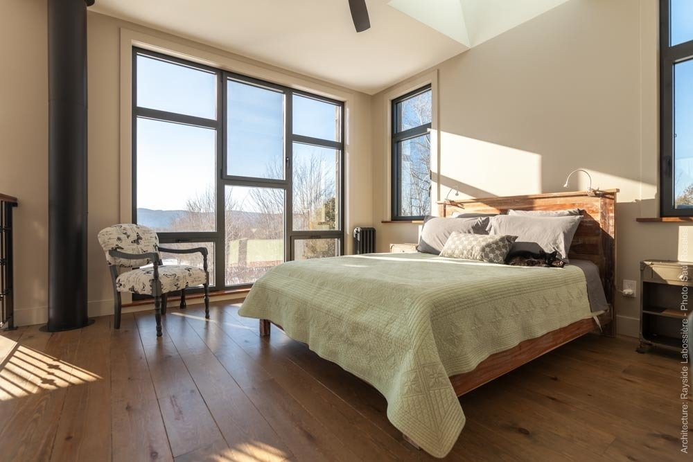 The main bedroom is opended on the house and has a view to die for.  La Maison Hatley