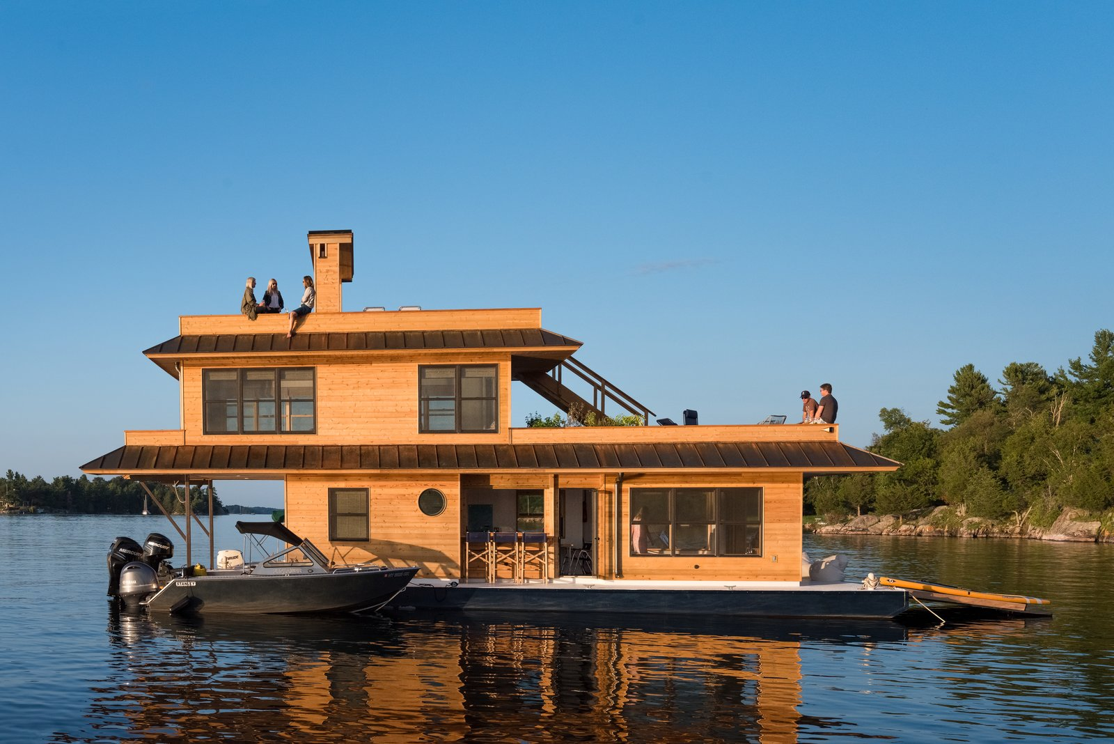 Exterior, House Building Type, Metal Roof Material, and Wood Siding Material When avid outdoorsman Richard Daigneault set out to create the ultimate, compact houseboat, his masterful woodworking skills and eco-friendly ethos produced a floating home so coveted that he launched a company to meet demand for his amphibious dwelling—with a starting price of $79,000 CAD (approximately $61,000 USD).  The Barge Yacht
