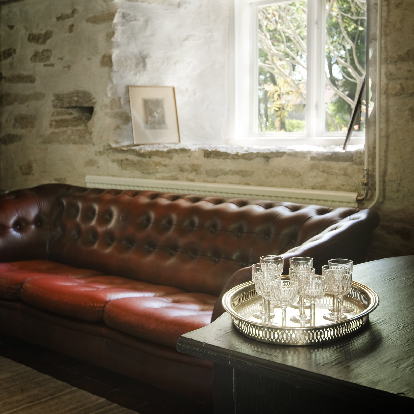 Chesterfield and brick walls  The lounge