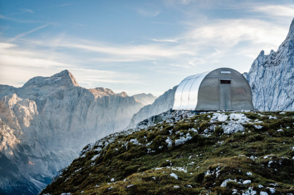 "Exterior, Metal Roof Material, Tiny Home Building Type, Cabin Building Type, Metal Siding Material, and Curved RoofLine AO, Alpine Shelter ""Bivak II na Jezerih""   Cabins & Hideouts from Slovenian mountain shelters and bivouacs"
