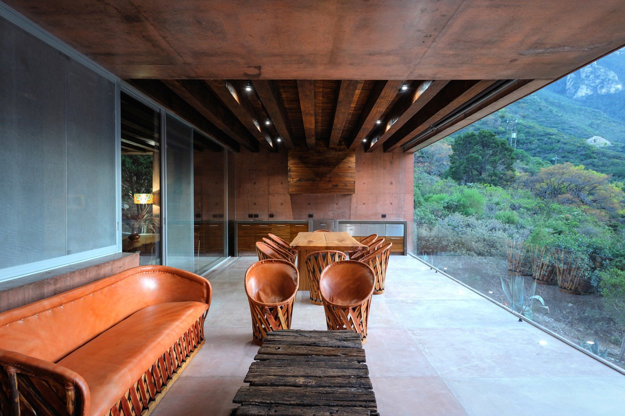 """Outdoor, Large Patio, Porch, Deck, and Concrete Patio, Porch, Deck """"The house acts as a large platform that floats above the tops of the cedars,"""" says the architect, P+0 Arquitectura.  Casa Narigua by P+0 Arquitectura"""