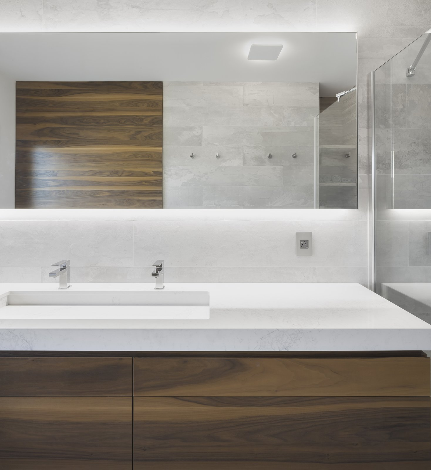 Bath Room, Undermount Sink, Ceiling Lighting, and Wall Lighting In modern bathroom vanities, rectangular shapes abound. The shape is showcased on this geometric vanity, where the drawers, countertop, sink, and knobs are all rectangular.  Photo 7 of 25 in 25 Best Modern Bathroom Vanities For Your Home from r3R