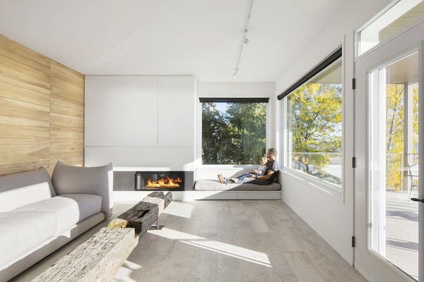 Serenity and purity of the elements inspired the concept of r3R residence, a project realized in an existing building. A low-lying modern fireplace design in the living room brings warmth to the space.
