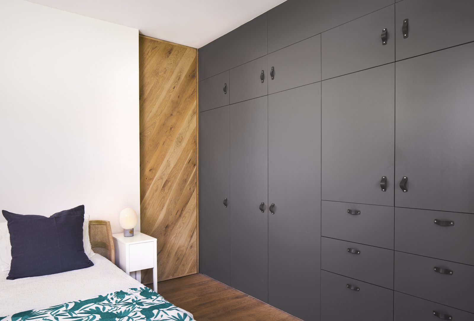 Full height closet storage cabinets and post oak pocket door.  Airole Way Residence