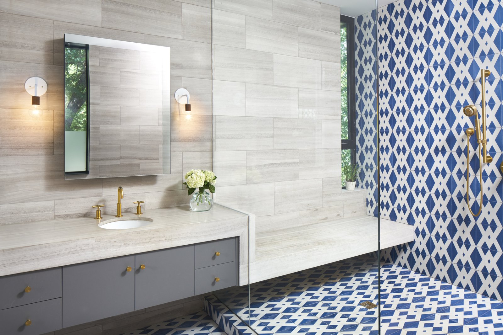Master bathroom vanity and  'wet room'. Materials are encaustic concrete tile, limestone tile.  Airole Way Residence