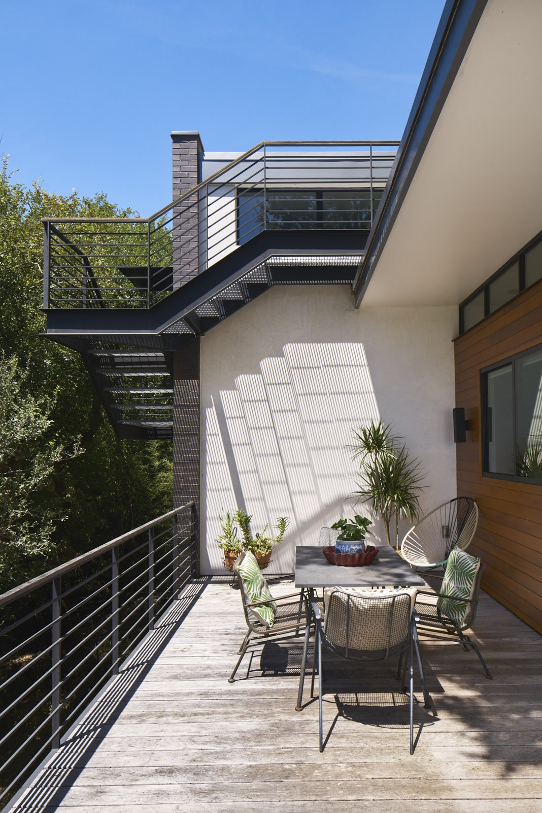 Cantilevered stair to roof deck overlooking patio.  Airole Way Residence