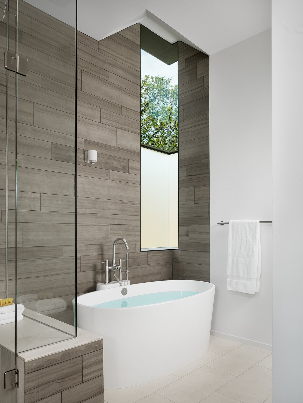 Master bathroom with marble tile and custom steel corner window.  Vance Lane Residence