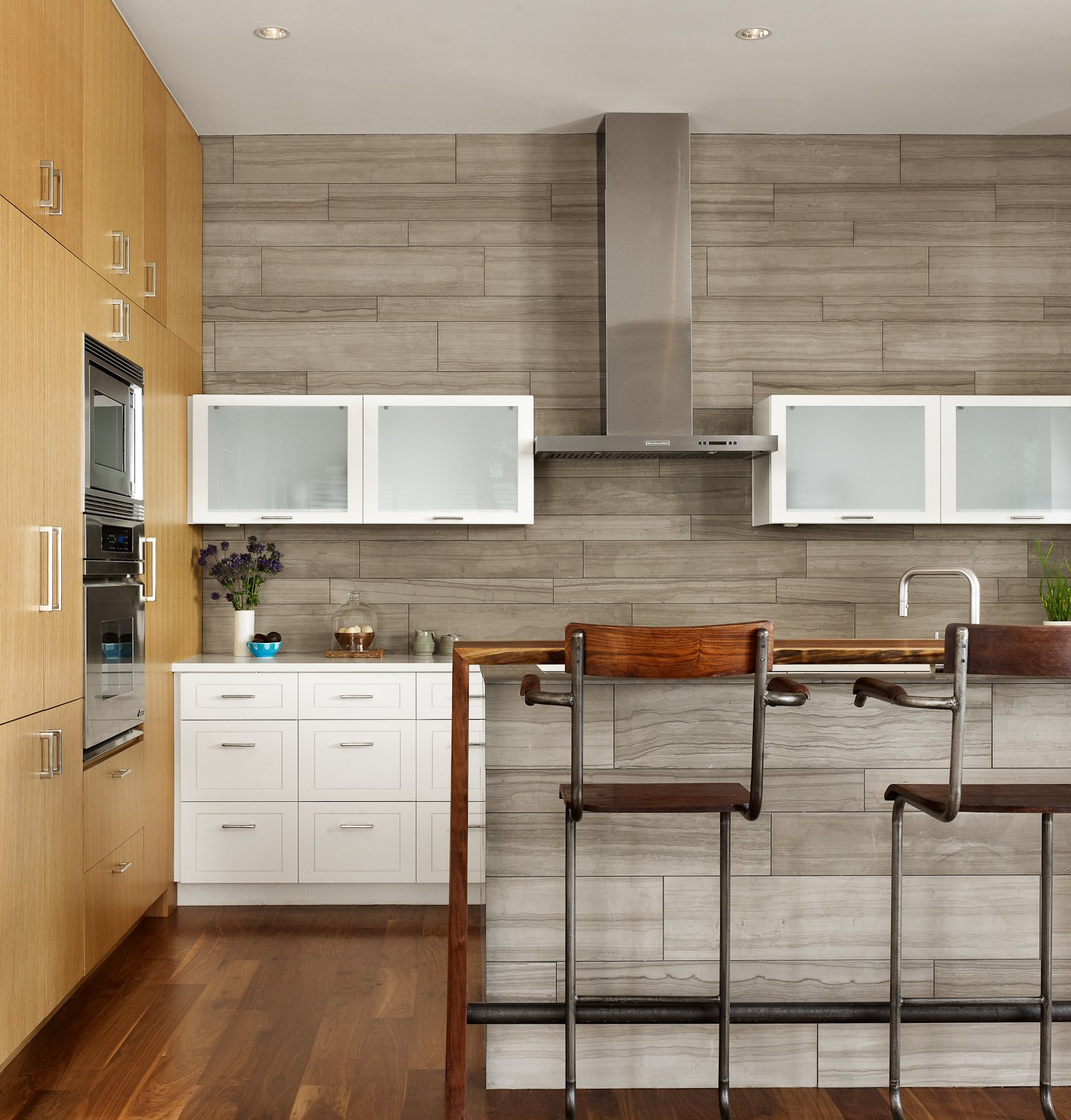 The Kitchen was designed with painted and natural wood finished cabinets.  Vance Lane Residence