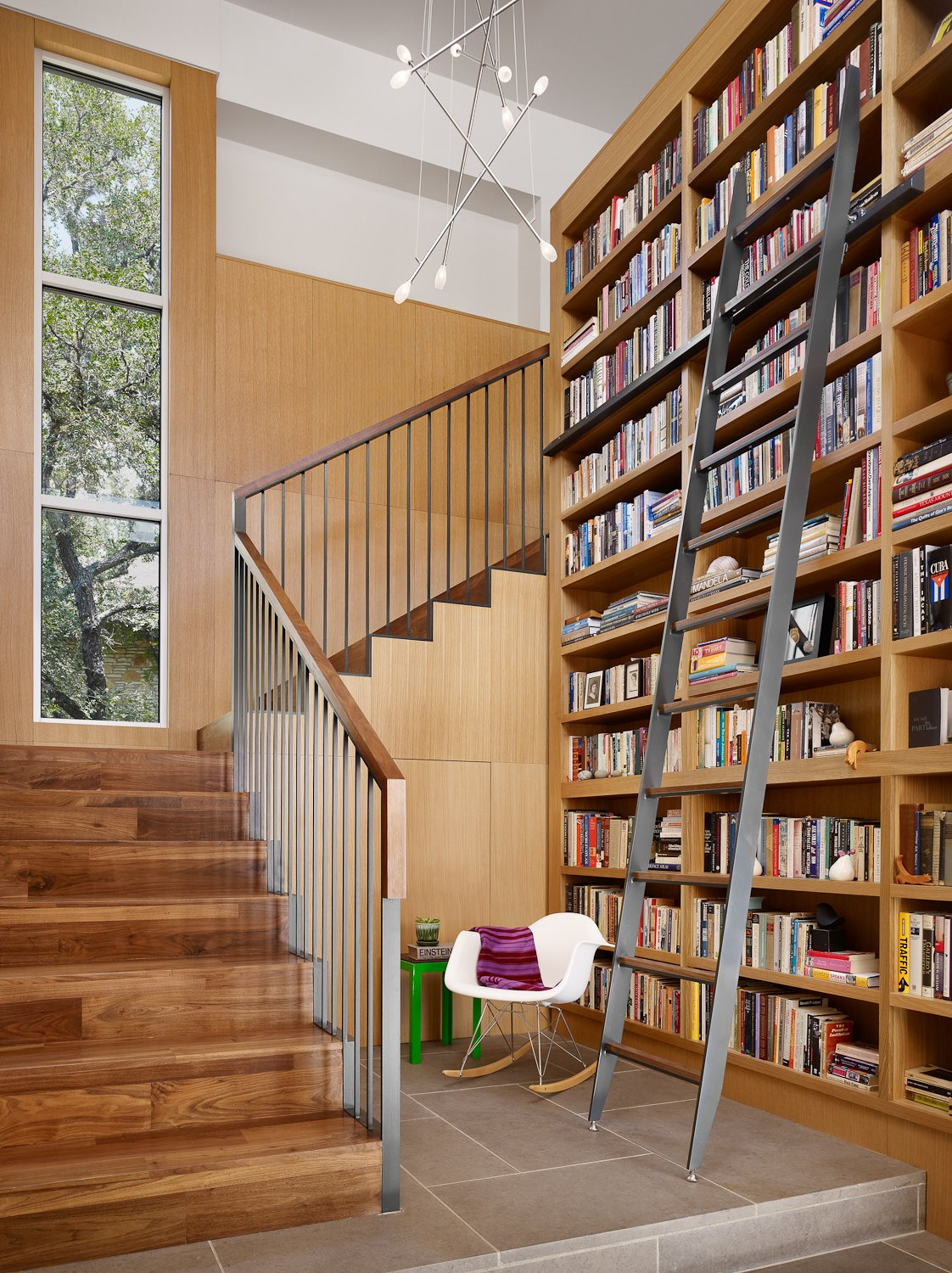Stair and Library reading nook and custom steel library ladder.  Vance Lane Residence