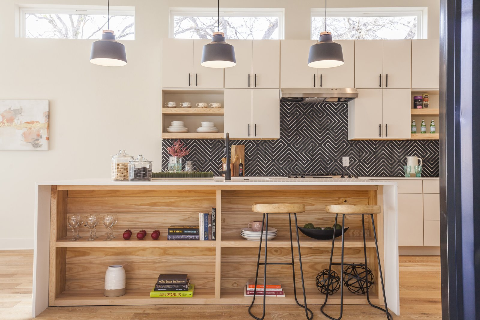 Kitchen, Wood, Engineered Quartz, Dishwasher, Concrete, Refrigerator, Open, Microwave, Light Hardwood, White, Undermount, and Pendant This is the Unit A Kitchen - a fun mix of warm colors and textures. 10/10 would buy :)  Kitchen Concrete Pendant Open Photos from The Reyes Duplex