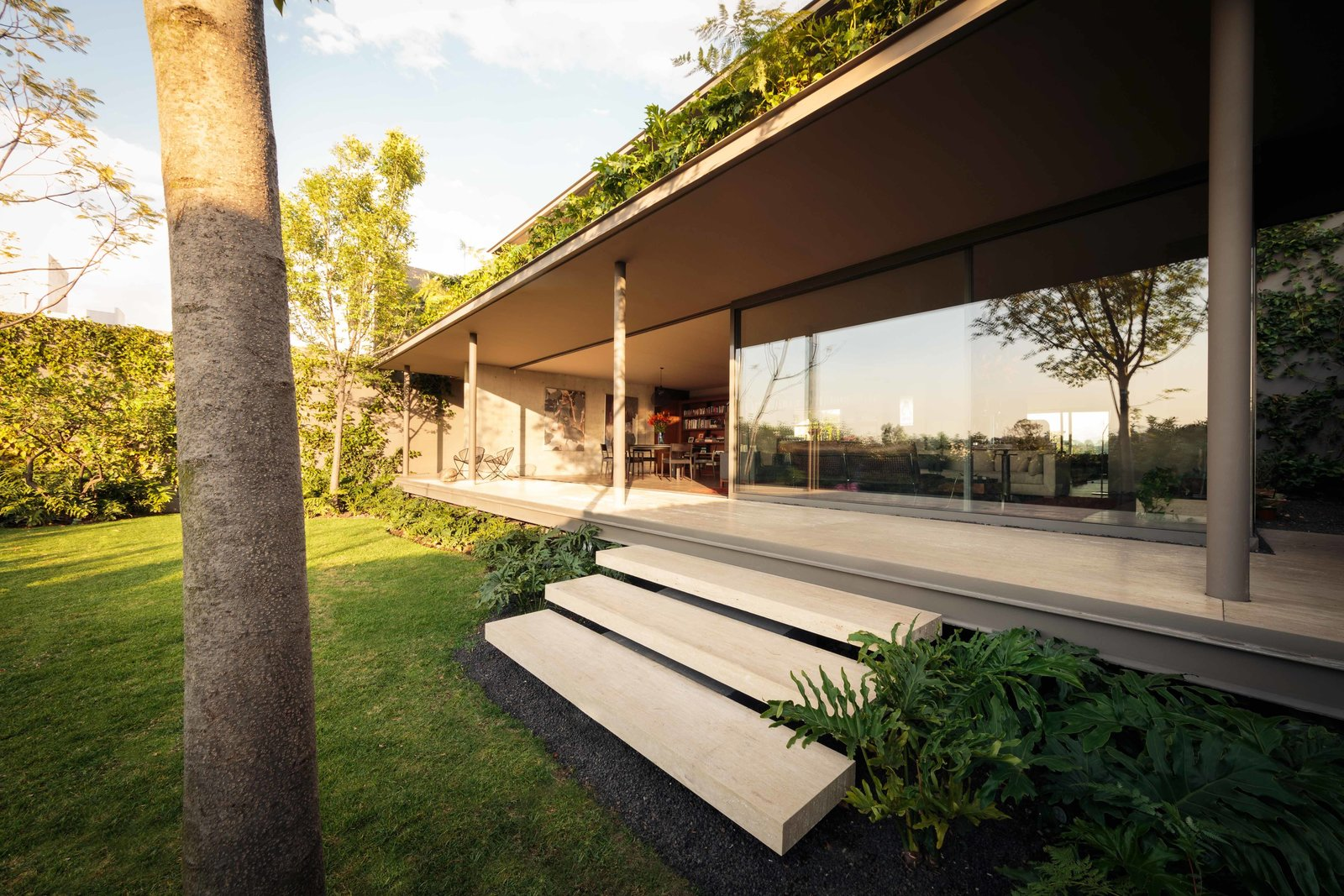 Outdoor, Trees, Shrubs, Grass, Back Yard, and Large Patio, Porch, Deck CAUCASO  Caucaso by Jose Juan Rivera Rio