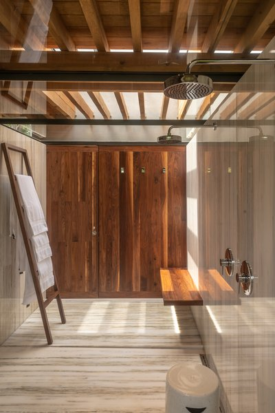 One of the luxurious bathrooms in Casa Santísimo by JJRR Arquitectura. It maintains a sense of natural intimacy despite its open plan and skylight ceiling.