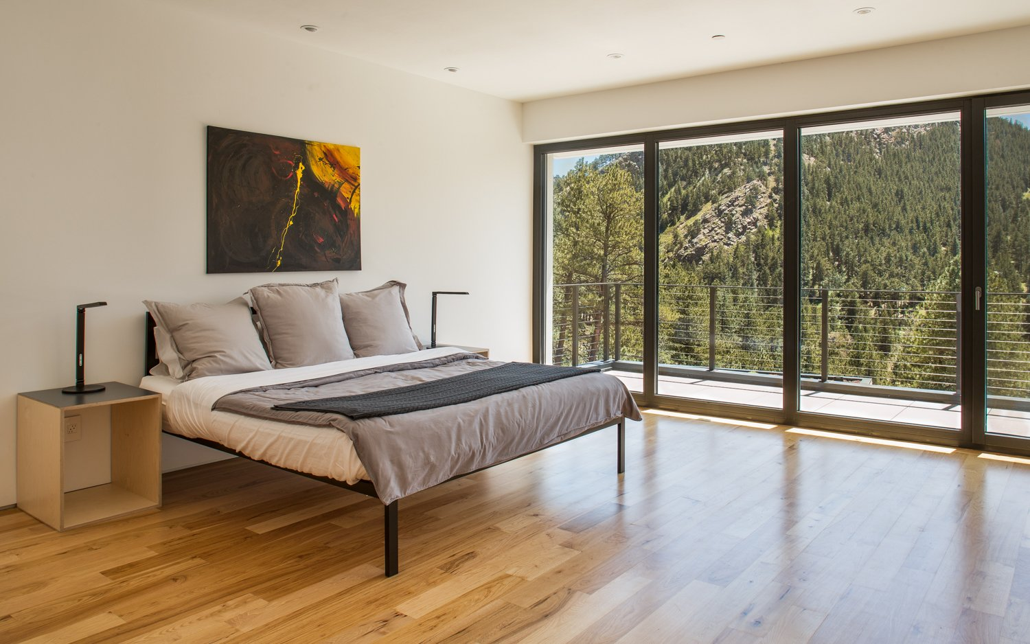 Bedroom, Bed, Ceiling Lighting, Medium Hardwood Floor, and Night Stands Main House Master Bedroom with a View  Best Photos from The Tesla of Boulder Homes Offered at $5,200,000