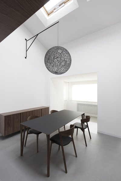 """The lamp is suspended over the table thanks  to this"""" iron arm"""" designed ad hoc  Home A236"""