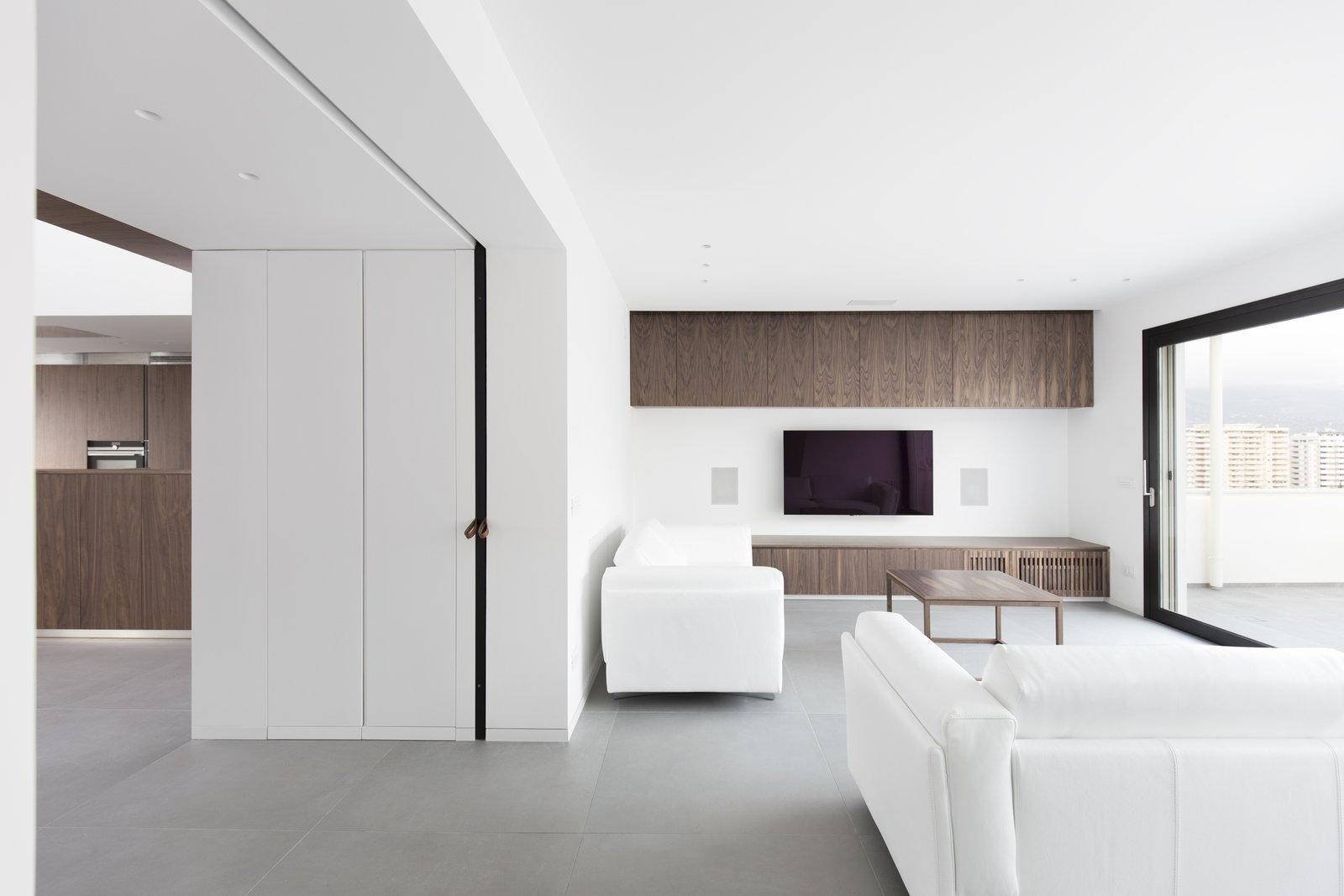 even in the living the dark walnut furniture has been designed by the architects  Home A236