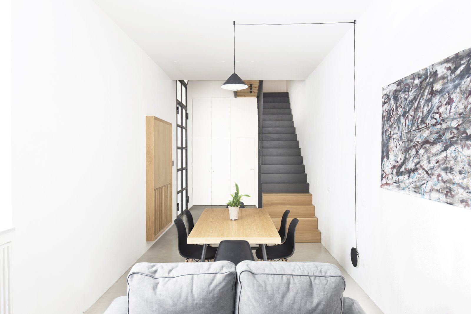 Living Room, Chair, Sofa, Ceiling Lighting, Floor Lighting, Table Lighting, and Pendant Lighting All furniture is made of oak wood except the staircase volume made entirely of black steel.  Best Photos from EXISTENZ MINIMUM- Palermo House A223