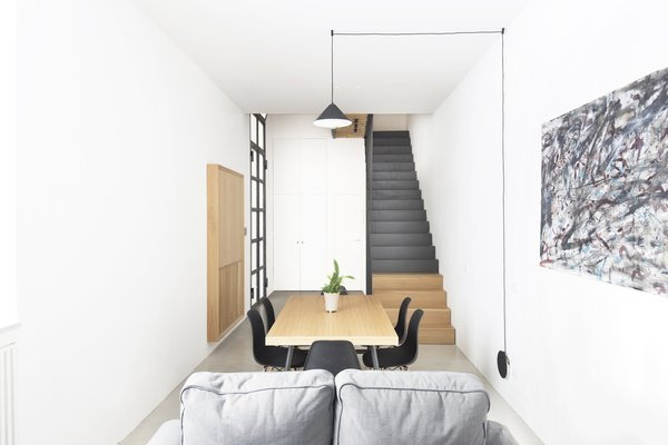 All furniture is made of oak wood except the staircase volume made entirely of black steel.
