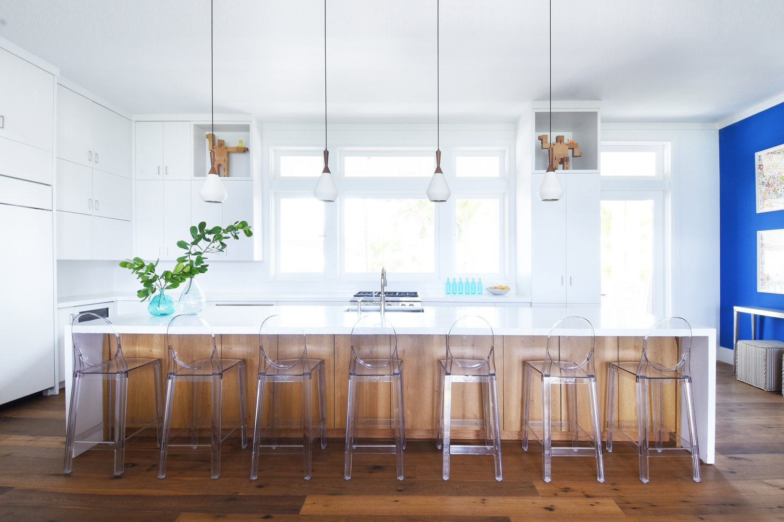 Kitchen, Engineered Quartz Counter, White Cabinet, Medium Hardwood Floor, Subway Tile Backsplashe, Refrigerator, Pendant Lighting, Range, Cooktops, Beverage Center, and Undermount Sink Kitchen  Best Photos from Bahamas Style