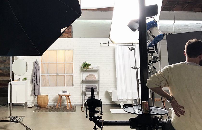 A true behind-the-scenes moment featuring our crew and custom built set; Source: Nicole LaMotte  Photo 7 of 7 in Bath Collection: Behind the Design + Styling Tips