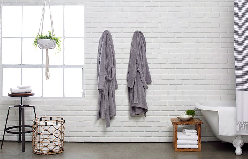 Classic Bathrobes, for lounging before or after your bathing rituals; Source: Nicole LaMotte/Parachute  Photo 5 of 7 in Bath Collection: Behind the Design + Styling Tips
