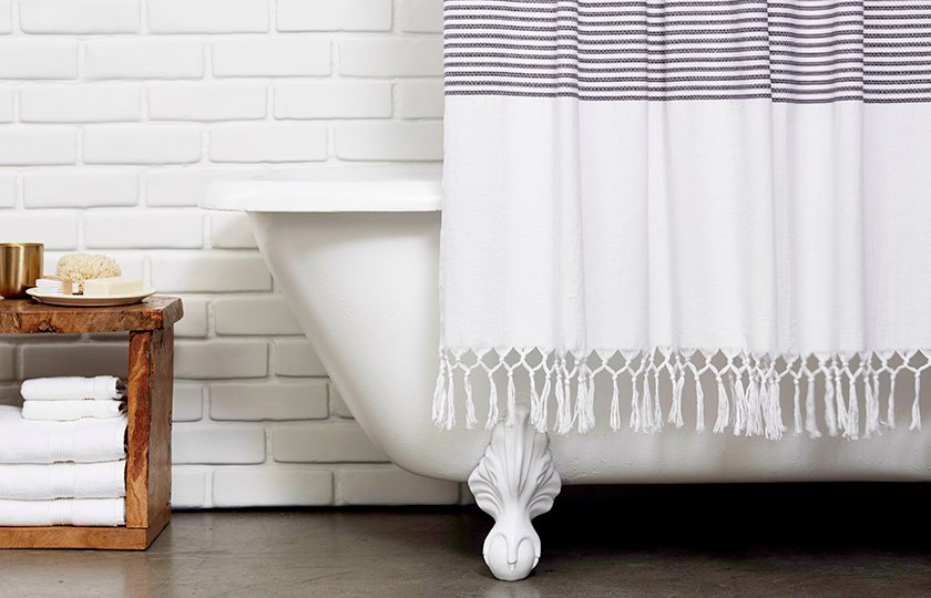 The Turkish Shower Curtain features a fetching, hand-knotted fringe hem; Source: Nicole LaMotte/Parachute  Photo 4 of 7 in Bath Collection: Behind the Design + Styling Tips