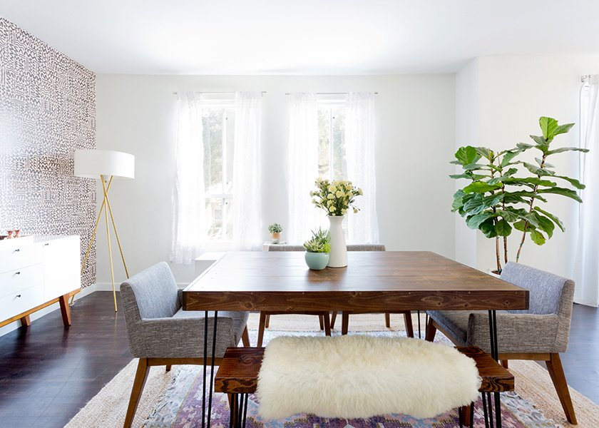 Dining table and bench: custom. Chanel Dining Chairs: Article. Mid-Century Tripod Floor lamp: West Elm. Tejn Faux Sheep Skin: Ikea; Source: Amy Bartlam/Parachute  Photo 5 of 11 in How to Design an Apartment You and Your Roommate Love