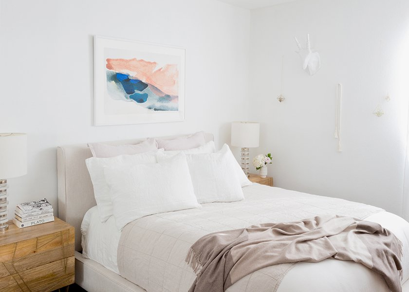 White Linen Bedding: Parachute. Oatmeal Essential Quilt: Parachute. Mushroom Striped Cashmere Throw: Parachute. Morning River Print: Minted. Dean Sand Queen Upholstered Panel Bed: Living Spaces. Roar + Rabbit Brass Geo Nightstands: West Elm. Clear Disc Table Lamps: West Elm; Source: Amy Bartlam/Parachute  Photo 7 of 11 in How to Design an Apartment You and Your Roommate Love