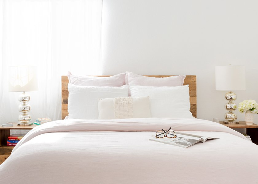 Blush Linen Bedding: Parachute. Blush Linen Euro Shams: Parachute. White Linen Pillowcases: Parachute. Emerson Reclaimed Wood Nightstands: West Elm. Abacus Table Lamps: West Elm; Source: Amy Bartlam/Parachute  Photo 9 of 11 in How to Design an Apartment You and Your Roommate Love