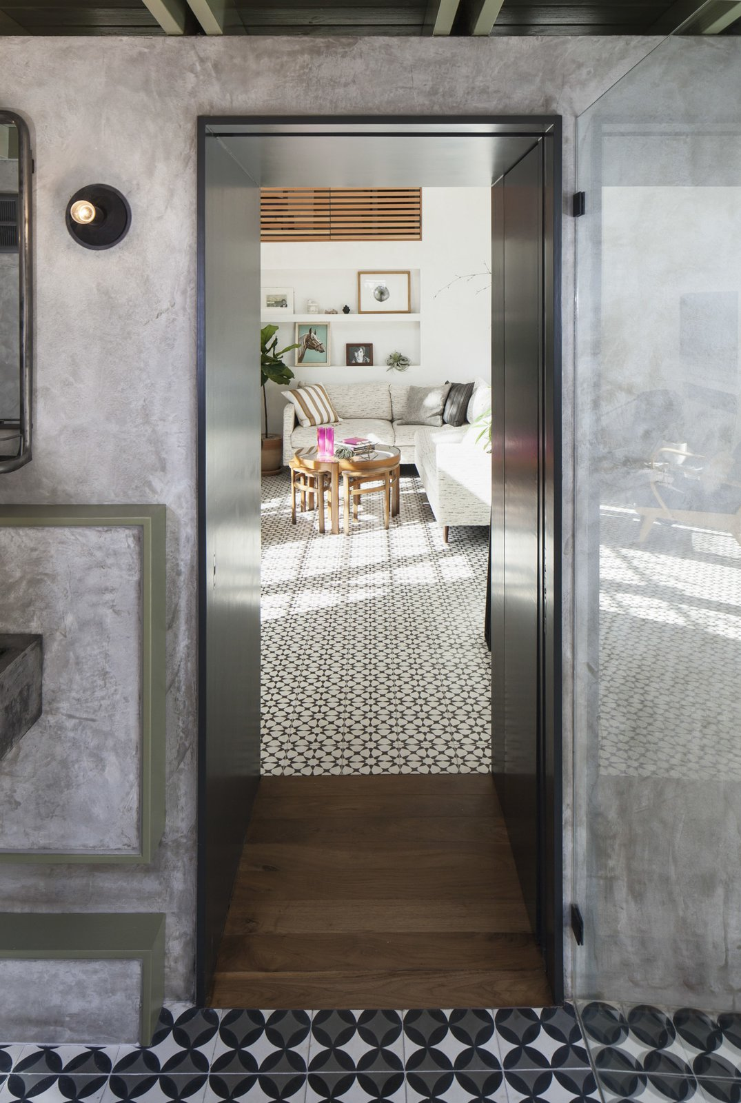 Doors and Interior Looking from the bathroom to the living space through the portal, which houses a small closet,  and also provides a spatial and material transition from private to public space .  Garner Pool & Casita