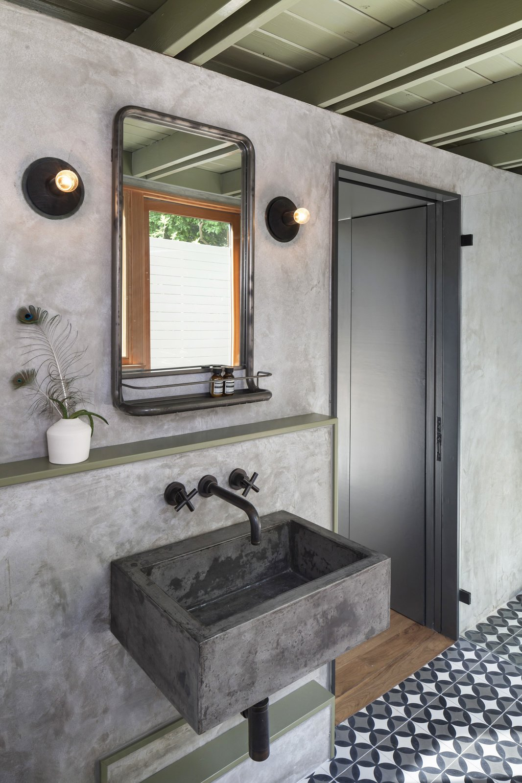 Bath Room, Wall Mount Sink, Wall Lighting, and Cement Tile Floor The new casita bathroom features a custom concrete sink, plaster walls, and custom concrete tile.  Garner Pool & Casita