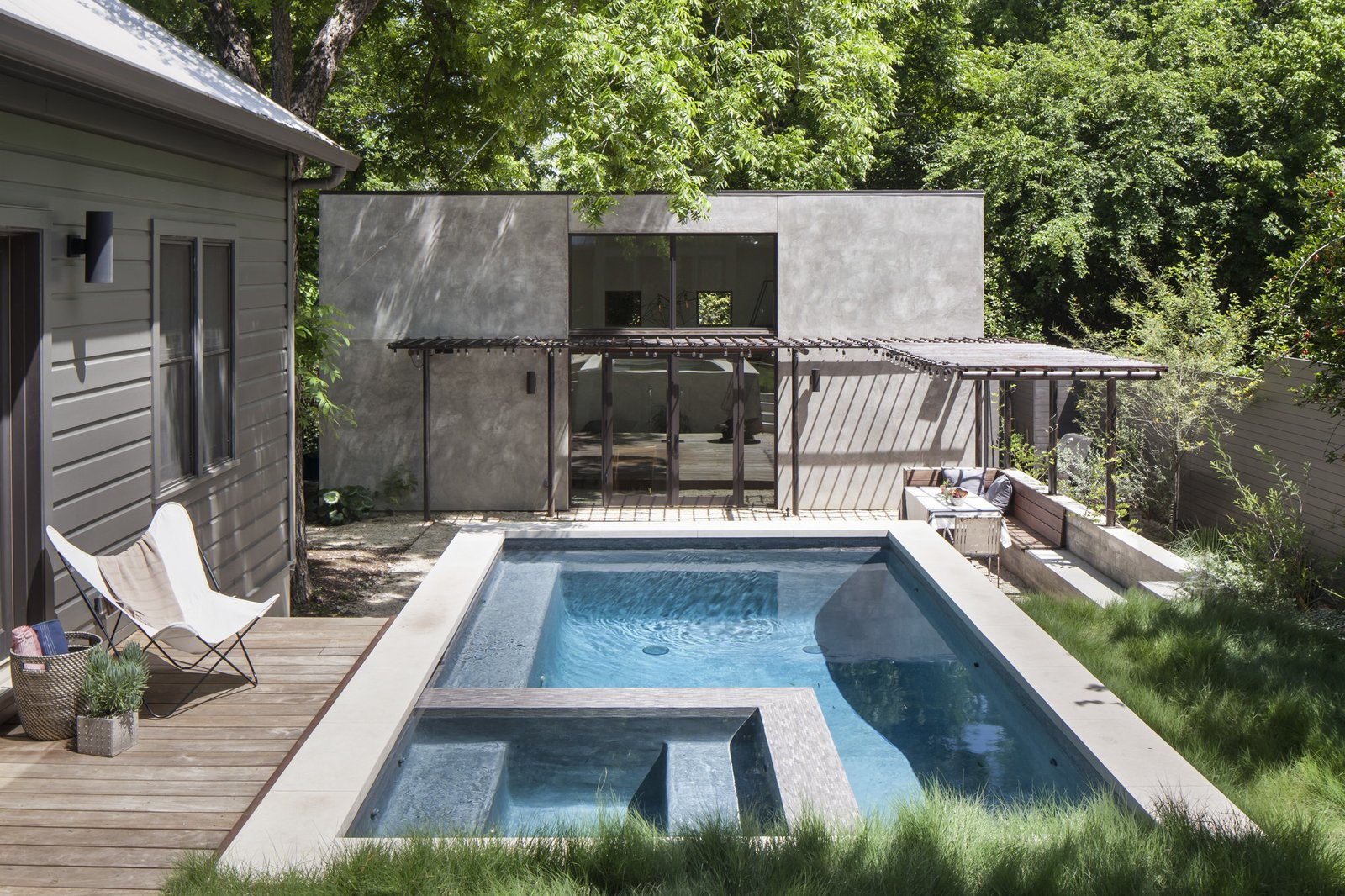 Outdoor, Wood Patio, Porch, Deck, Walkways, Concrete Pools, Tubs, Shower, and Grass Looking from new back porch towards the new pool, casita building, and new outdoor living space.  Photo 9 of 21 in Dwell Community's Top 20 Homes of 2017 from Garner Pool & Casita