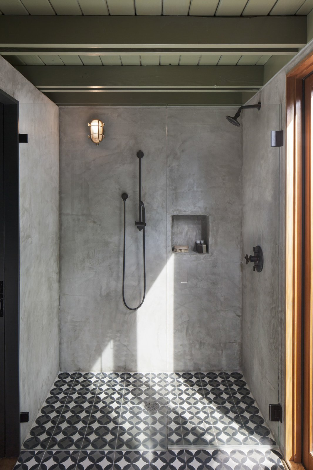 Bath Room, Cement Tile Floor, Wall Lighting, Full Shower, and Enclosed Shower The concrete tile transitions into the plaster shower for a seamless look.  Bathe