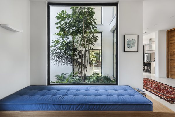 Ravit Dvir Architecture and Design installed windows and kept furnishings scarce to open up The House in Harutzim. This cobalt blue bench offers a sweeping view of the inner courtyard.