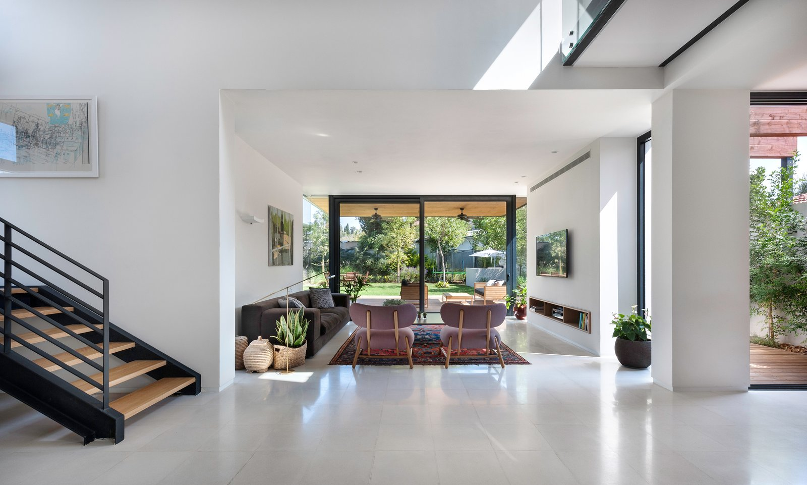 Living Room, Floor Lighting, Chair, Coffee Tables, Sofa, and Limestone Floor Ravit Dvir Architecture and Design  The House in Harutzim