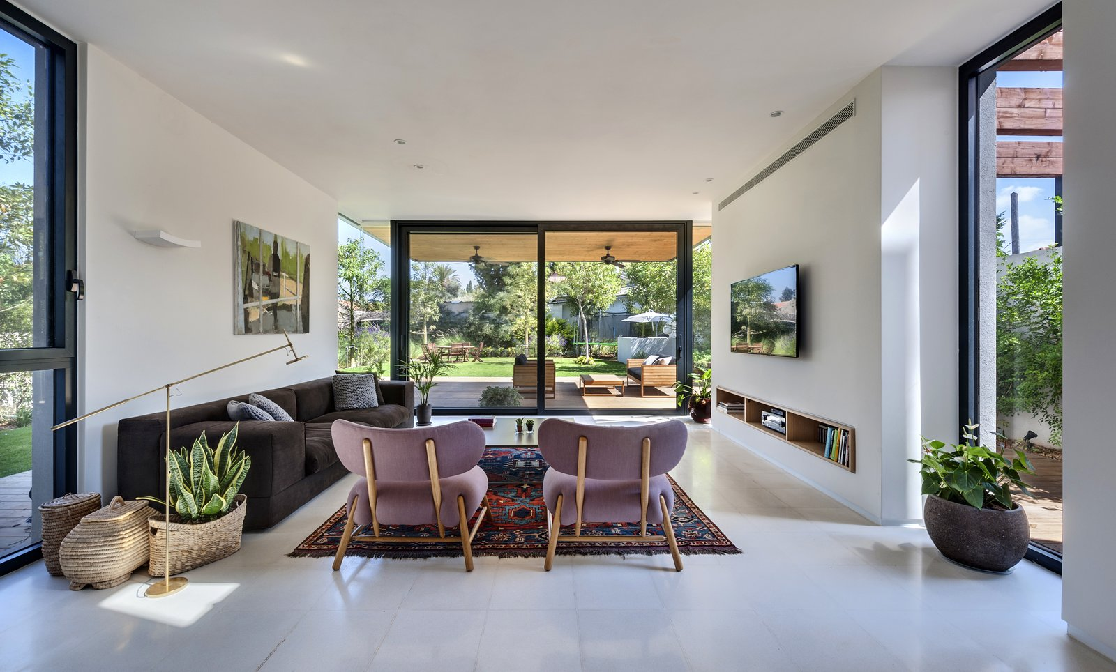 Living Room, Floor Lighting, Limestone Floor, Sofa, Chair, and Coffee Tables Ravit Dvir Architecture and Design  The House in Harutzim