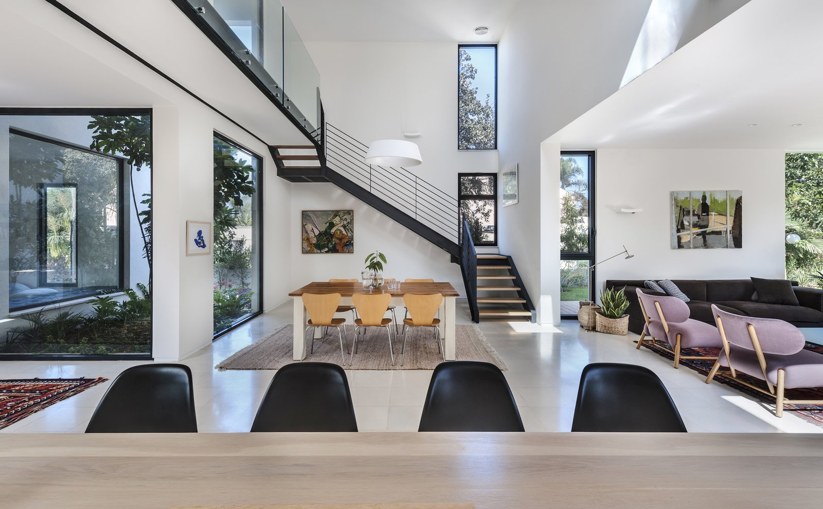Staircase, Wood Tread, Metal Tread, and Metal Railing Ravit Dvir Architecture and Design  The House in Harutzim