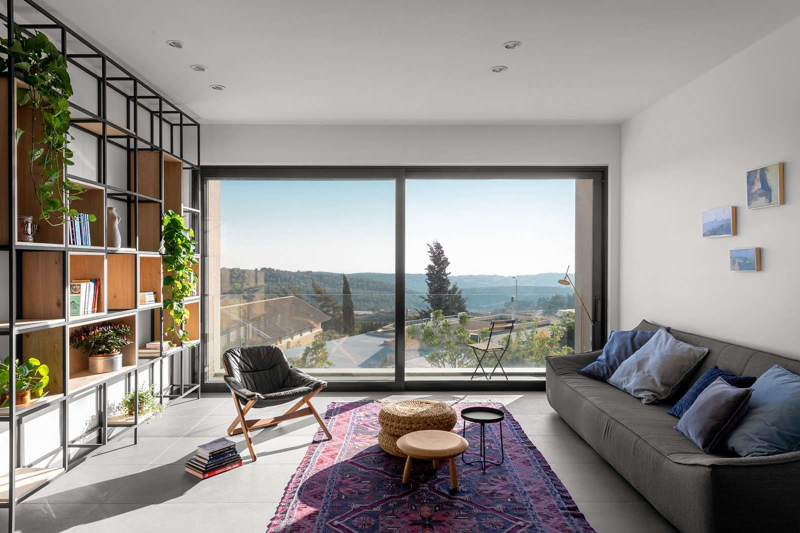 Living, Floor, Coffee Tables, Sofa, Bookcase, Ceramic Tile, Wood Burning, and Ceiling Ravit Dvir Architecture and Design  Living Ceramic Tile Sofa Bookcase Photos from The house in Mei Ami