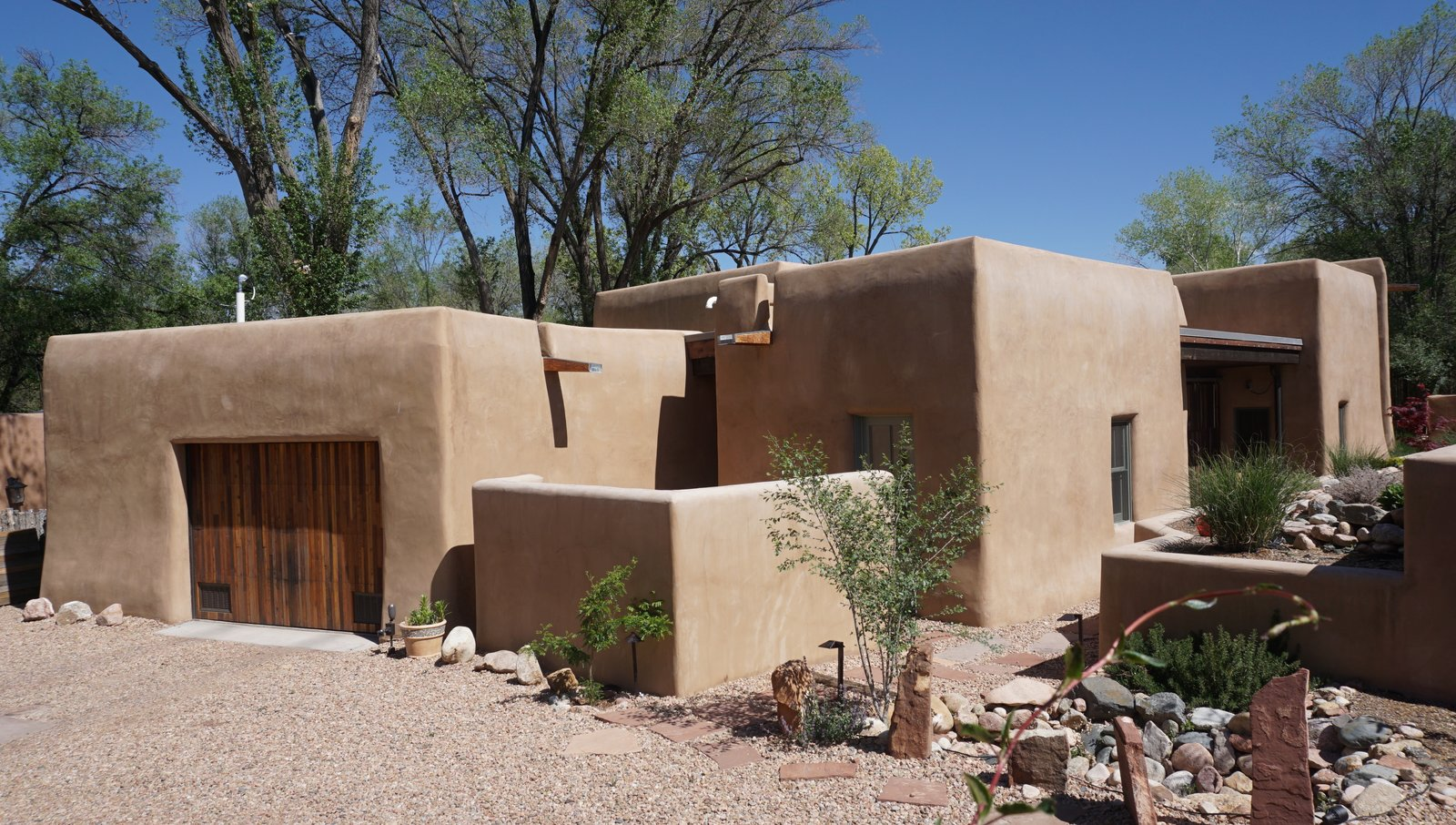 Exterior, House Building Type, Stucco Siding Material, Wood Siding Material, and Stone Siding Material Exterior View from Driveway  Santa Fe East Side Home by Ju Tan