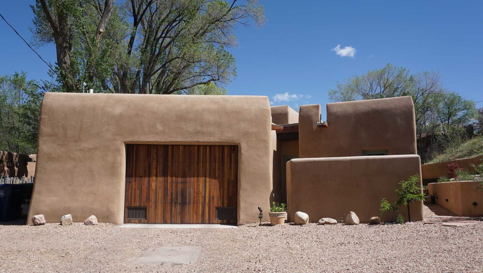Exterior, House Building Type, Stucco Siding Material, and Wood Siding Material Front Street View  Santa Fe East Side Home by Ju Tan