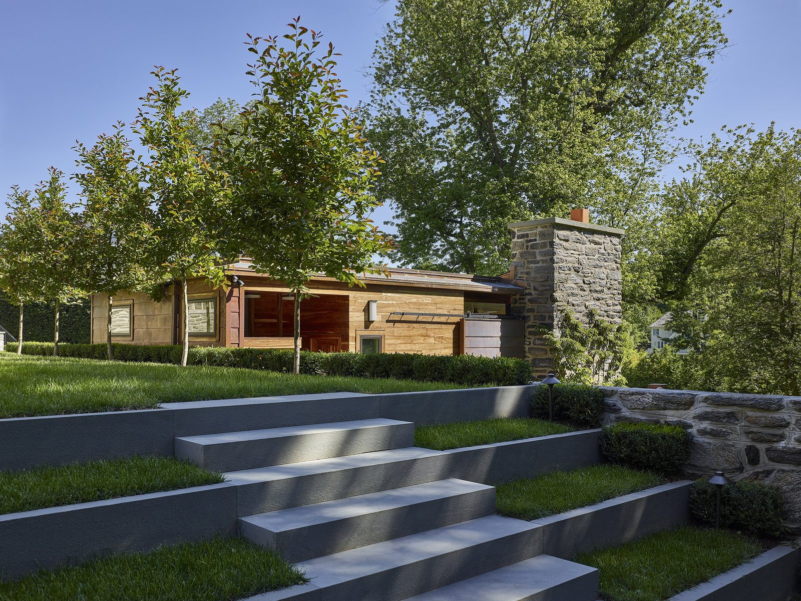 Outdoor, Side Yard, Shrubs, Trees, Stone Patio, Porch, Deck, Grass, and Walkways Stone terrace steps  Modern Pool House by Wyant Architecture