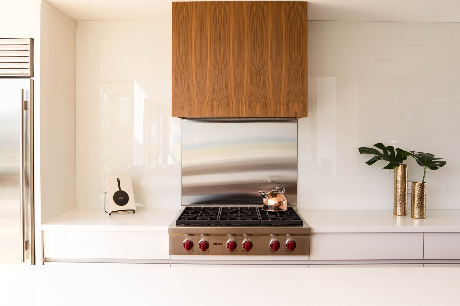 The Sub-Zero and Wolf appliances, which include a fridge, cook top, and a wall oven, were selected for both their performance capabilities, as well as their aesthetic appeal, which suited the contemporary design of the kitchen.  Ravine House by FrankFranco Architects