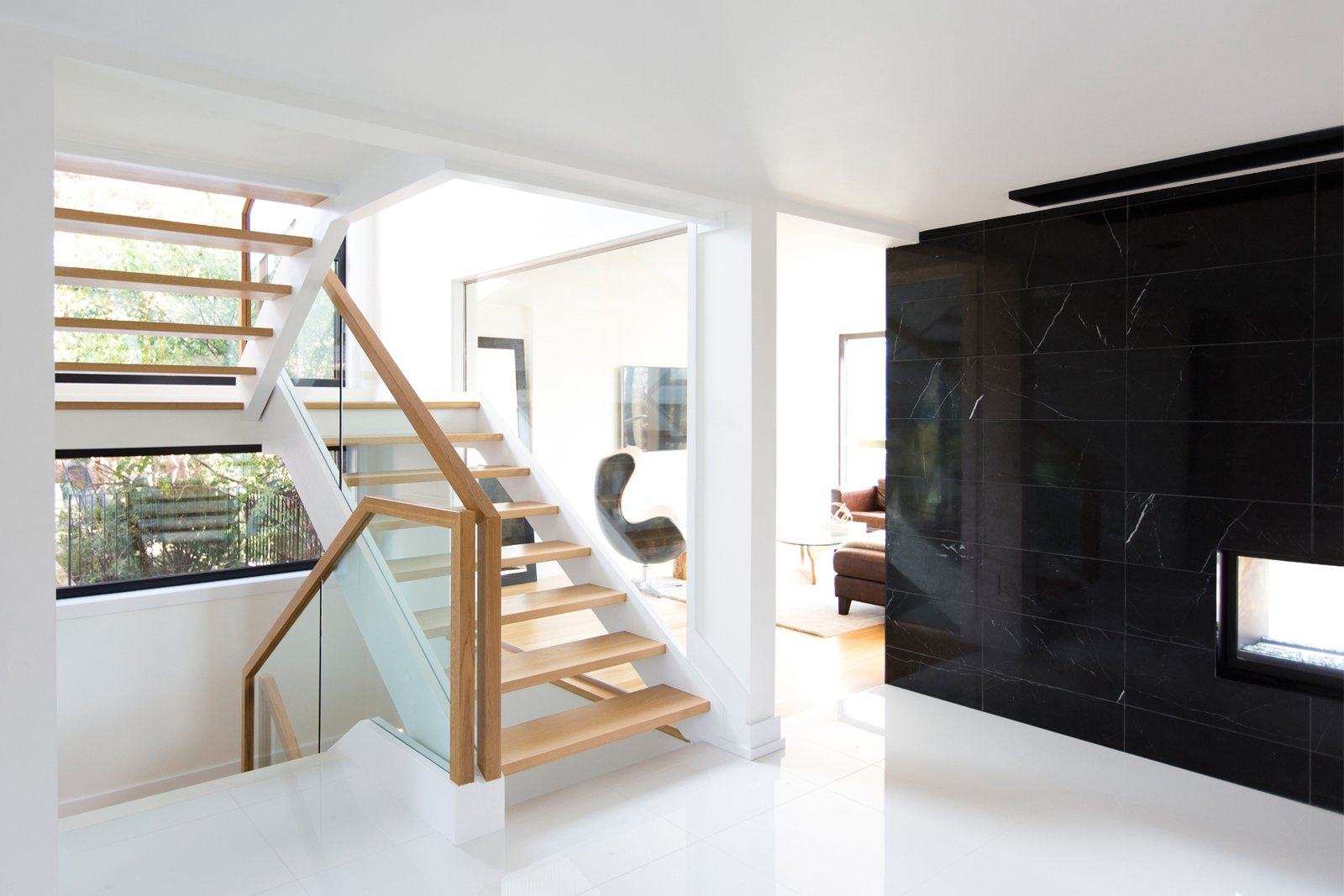 The staircase was relocated to enlarge the entrance foyer and improve the flow of space.  Ravine House by FrankFranco Architects
