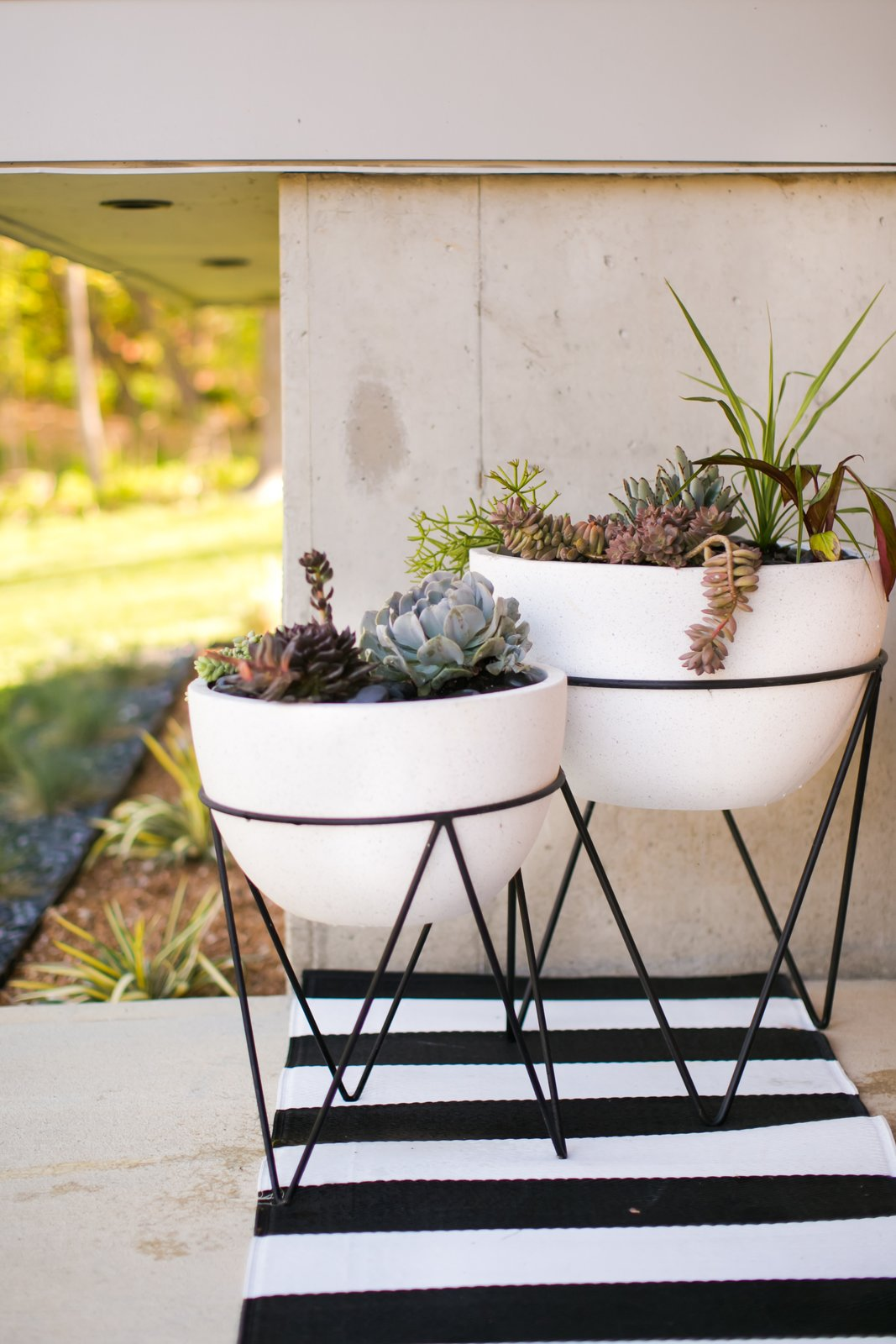 Front porch planters with mid-century modern inspired chevron base  20+ Ways to Design with Planters by Allie Weiss from The Sangar House
